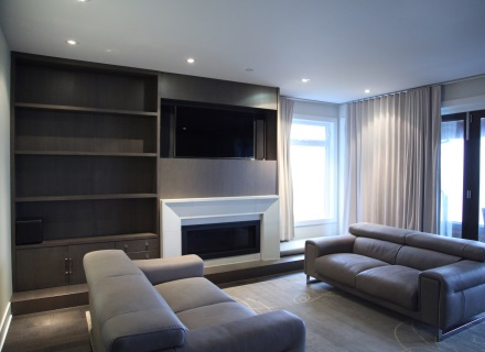 A television installed above the fireplace in a home in Vancouver BC.