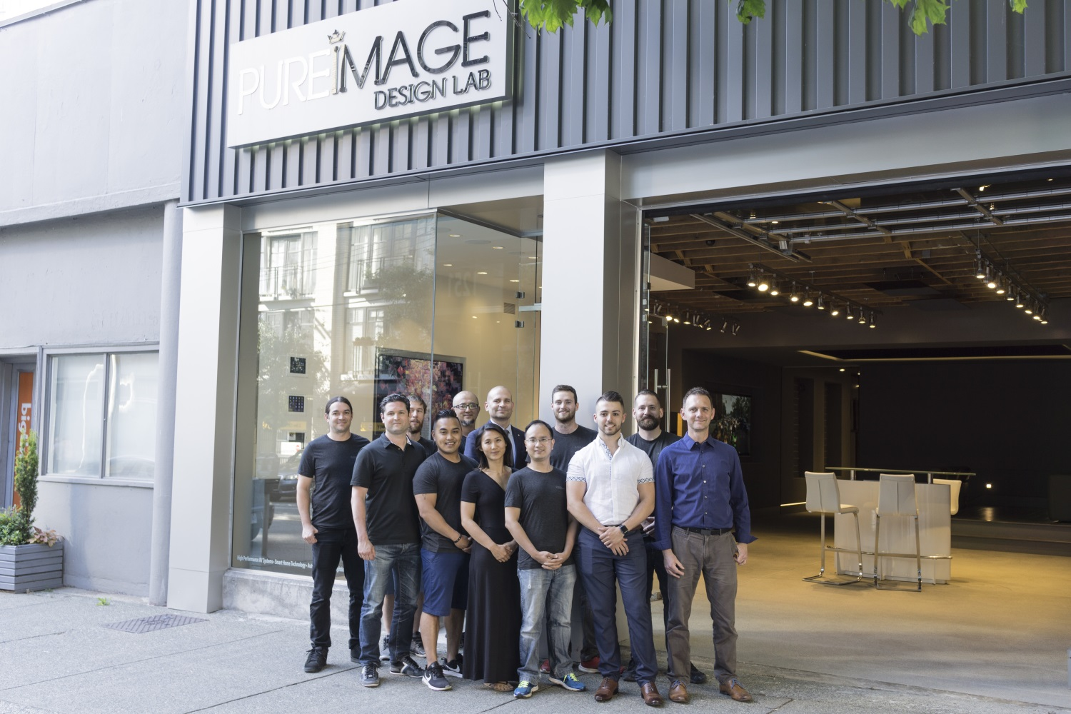 PureImage Vancouver's team photo showing specialists in home theatre, home automation and technology projects.