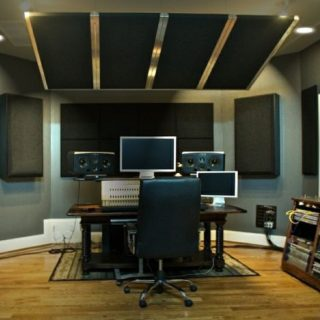 Black acoustic panels installed in a studio.