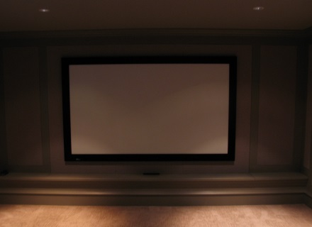 Draper fixed screen installed in a home theatre in Vancouver.